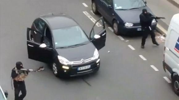Still image taken from amateur video shows gunmen fleeing the offices of French satirical newspaper Charlie Hebdo, after killing at least 12, in Paris