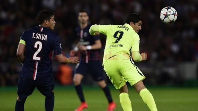 Suarez (în galben) a făcut o partidă mare în Hexagon (foto: uefa.com)
