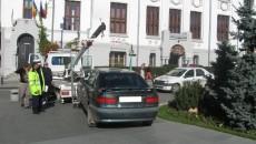 Potrivit legii, agenții Poliției Locale Craiova pot dispune ridicarea mașinilor staționate neregulamentar