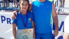 Ştefania Priceputu, medaliata cu aur, alături de antrenorul său, Valentin Boboşca