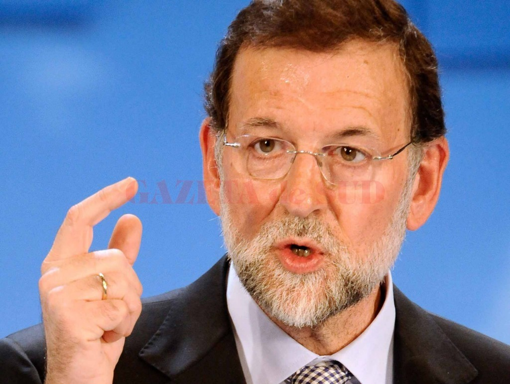 Spain's centre-right People's Party leader Mariano Rajoy gestures during a campaign rally in Santander