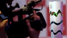 A cameraman shoots the Rio 2016 Olympic torch during a National Sports Forum seminar in Sao Paulo