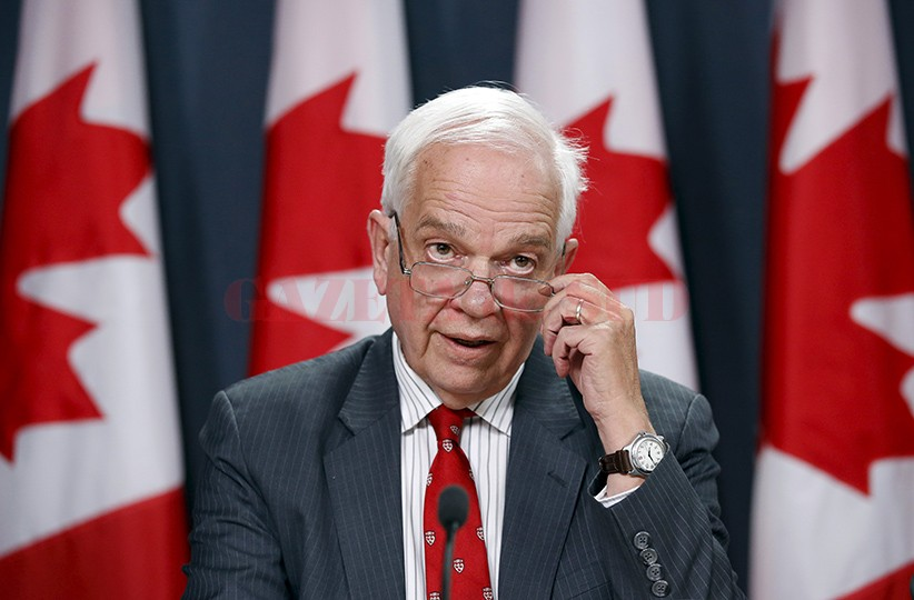 Canada's Immigration Minister McCallum speaks during a news conference in Ottawa