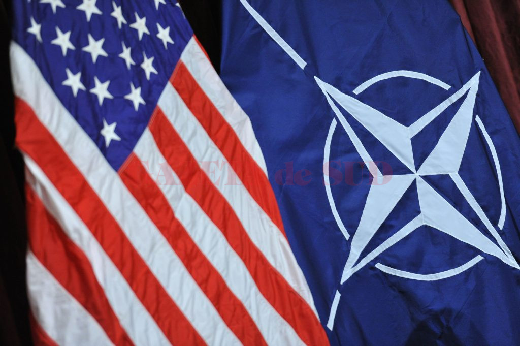 The flag of the USA and the NATO-flag