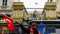 A-man-waves-a-Turkish-flag-in-front-of-t