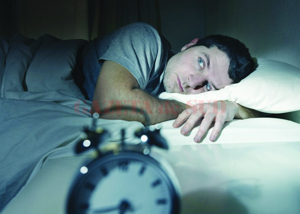 man in bed with eyes opened suffering insomnia and sleep disord