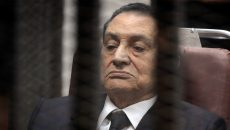 CAIRO, EGYPT - MARCH 19: Ousted Egyptian president Hosni Mubarek, in suit, appears in the trial about expenses for presidential palaces on March 19, 2014 in Cairo, Egypt. (Photo by Ahmed el Masry/Anadolu Agency/Getty Images)