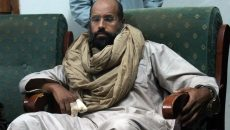 FILE - In this Saturday, Nov. 19, 2011 file photo, Seif al-Islam is seen after his capture in the custody of revolutionary fighters in Zintan. Libyan court sentences Gadhafi's son, Seif al-Islam, to death over killings in 2011 uprising on Tuesday, July 28, 2015. (AP Photo/Ammar El-Darwish, File)