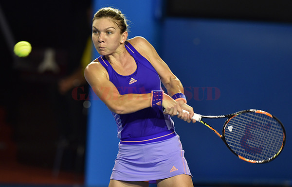 Romania's Simona Halep plays a shot during her women's singles match against Australia's Jarmila Gajdosova on day three of the 2015 Australian Open tennis tournament in Melbourne on January 21, 2015. AFP PHOTO / PAUL CROCK -- IMAGE RESTRICTED TO EDITORIAL USE - STRICTLY NO COMMERCIAL USE        (Photo credit should read PAUL CROCK/AFP/Getty Images)