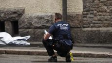 A policeman investigates at a crime scene where an intoxicated man hit people with his car, on July 28, 2017 downtown Helsinki. One person has died and few others have been injured.   / AFP PHOTO / Lehtikuva / Roni Rekomaa / Finland OUT
