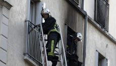 Firefighters work at the scene where a fire in an apartment building in the Myrha street, north of Paris, killed eight people early on September 2, 2015. A fire in an apartment building in northern Paris early Wednesday that killed eight people, including two children, might have been started intentionally, officials said. The blaze in the 18th district of the French capital, at the foot of the Montmartre hill and its tourist attractions, took more than 100 firefighters to contain it. AFP PHOTO / KENZO TRIBOUILLARD / AFP PHOTO / KENZO TRIBOUILLARD