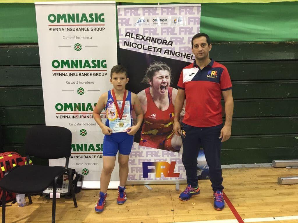 Antrenorul Aurel Cimpoeru alături de medaliatul cu aur de la Pitești, David Boicea
